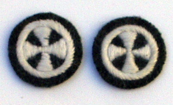Pair of embroidered cross sleeve insignia.